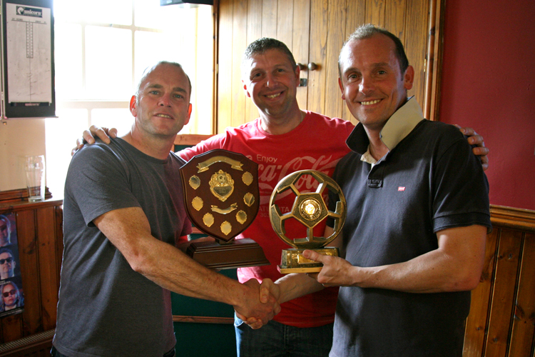 Anthony Woosey collects the trophy from Carl Worsnip and Martin Ellis